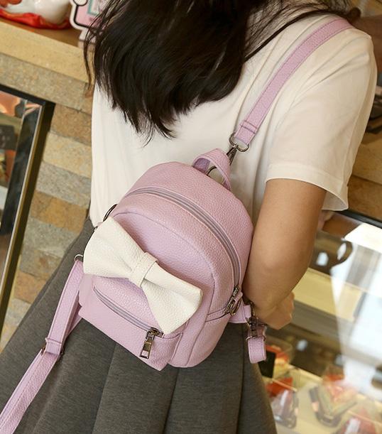 พร้อมส่ง กระเป๋าผู้หญิง สะพายข้างหรือปรับเป็นเป้สะพายหลังได้ ไซร์เล็ก แต่งโบว์ แฟชั่นเกาหลี รหัส G-199 สีม่วง