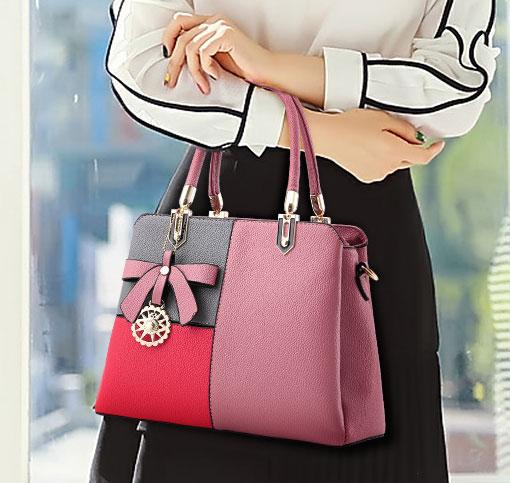 ขายส่งกระเป๋าผู้หญิงถือและสะพายข้าง เย็บสลับสีแต่งโบว์แฟชั่นสไตล์ยุโรป รหัส Yi-8165 สีชมพูสลับ