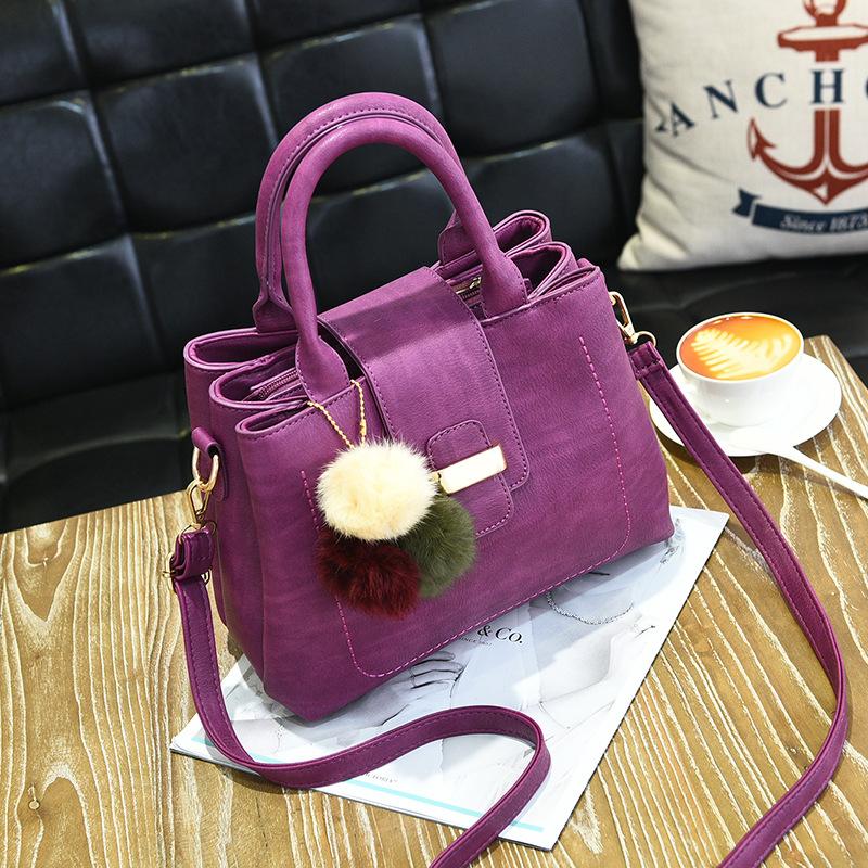 ขายส่ง กระเป๋าผู้หญิงถือและสะพายข้าง เรียบหรู 3 ช่องเก็บของรหัส KO-854 สีม่วง *แถมปอม3สี