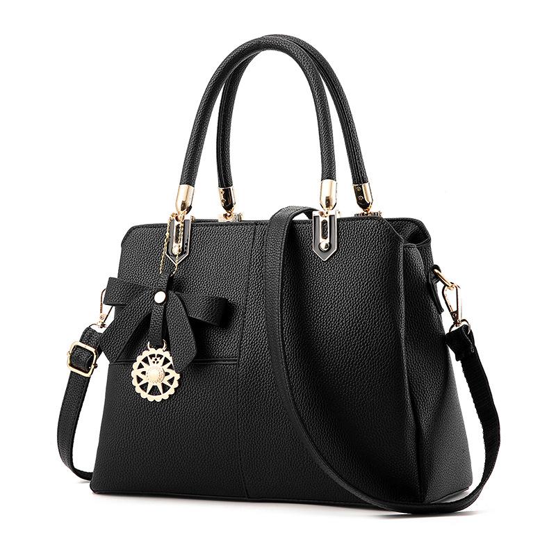 ขายส่งกระเป๋าผู้หญิงถือและสะพายข้าง เย็บสลับสีแต่งโบว์แฟชั่นสไตล์ยุโรป รหัส Yi-8165 สีดำ