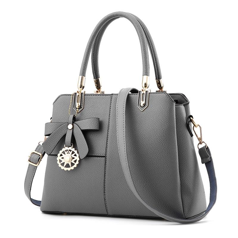ขายส่งกระเป๋าผู้หญิงถือและสะพายข้าง เย็บสลับสีแต่งโบว์แฟชั่นสไตล์ยุโรป รหัส Yi-8165 สีเทา